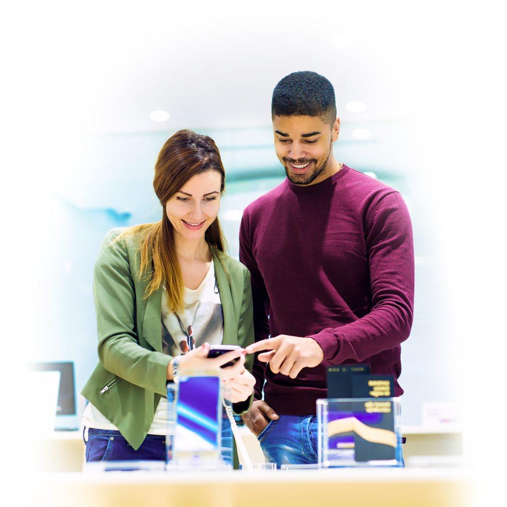 woman and man shopping for a new device