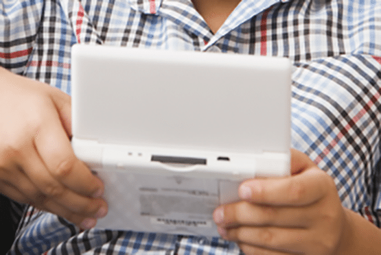 Man playing on the new nintendo 3ds xl