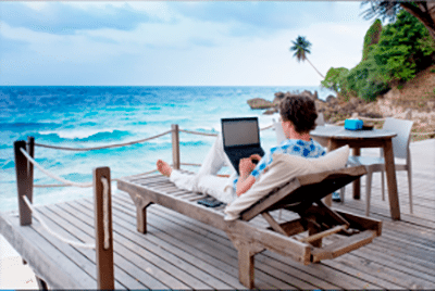 Man practicing computer safety on a beach vacation