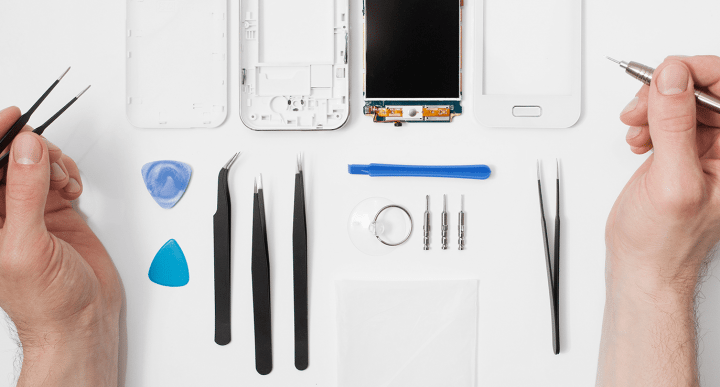 disassembled phone with repair tools